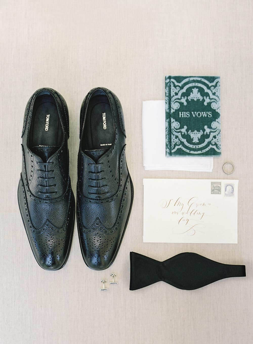 groom attire and velvet vow book