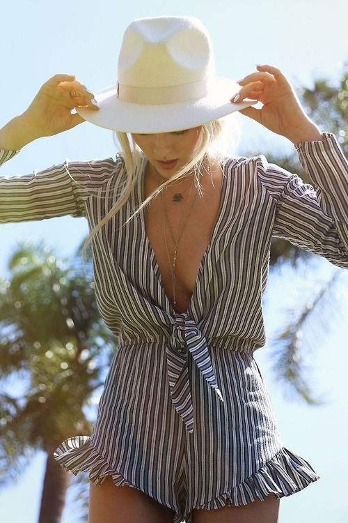 a striped black and white beach romper with long sleeves is all you need for a wow look