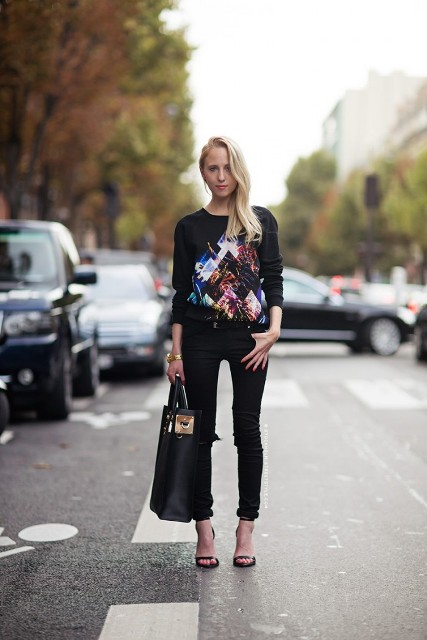 With printed sweatshirt, black skinny pants and high heels
