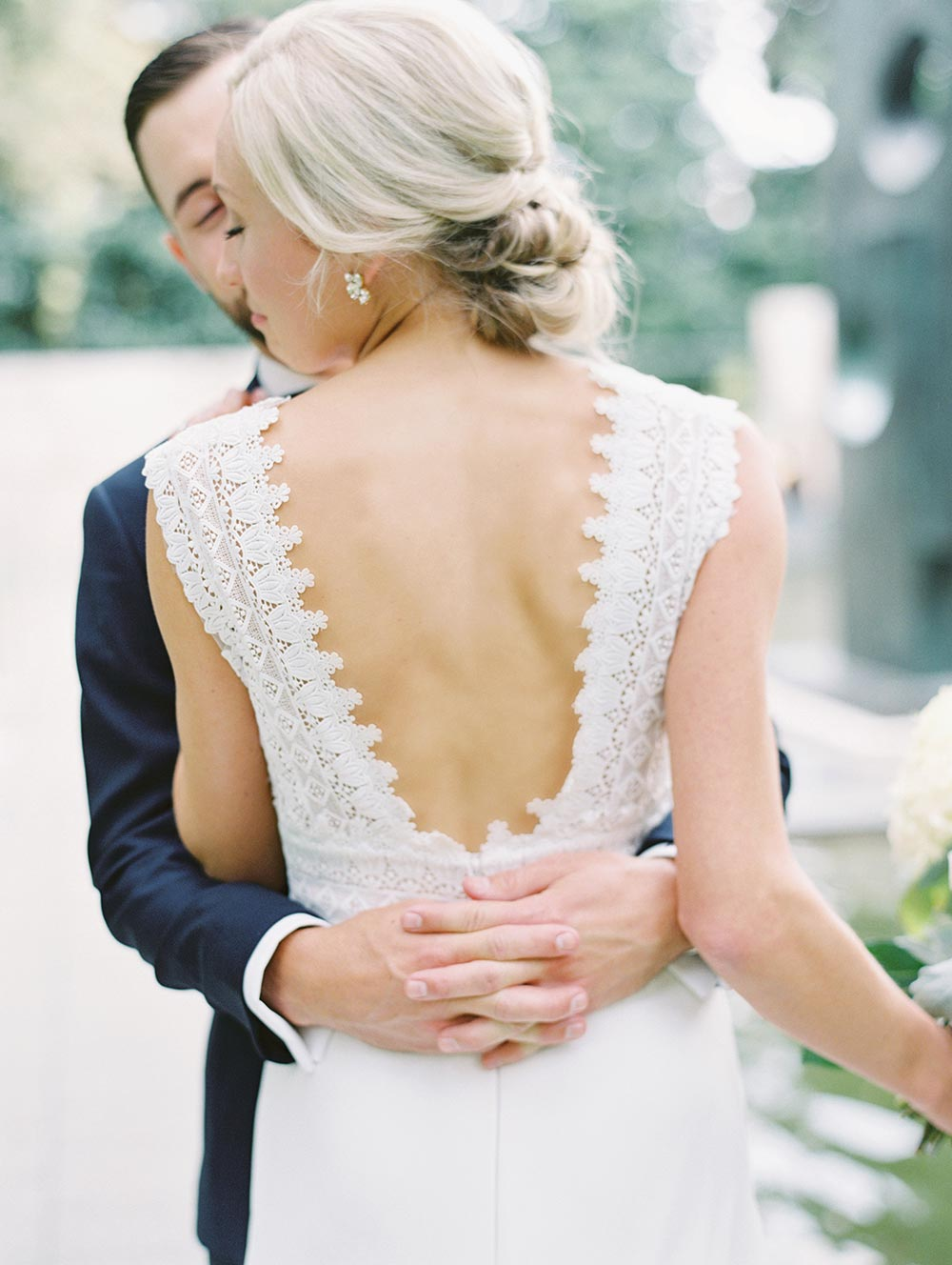 embroidered lace wedding dress with plunging back