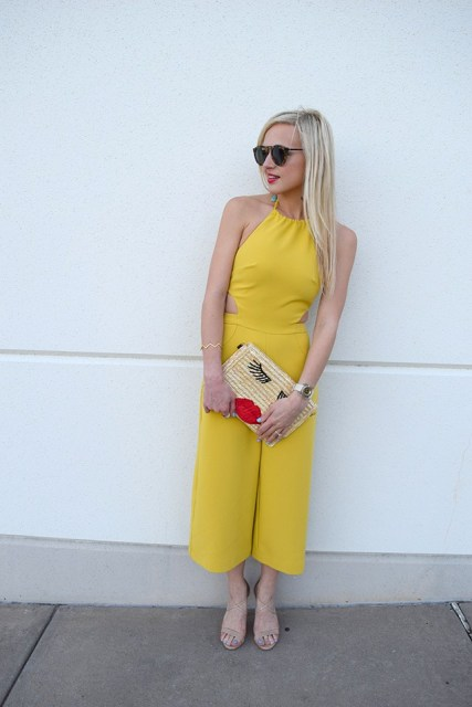 With beige sandals, sunglasses and printed clutch