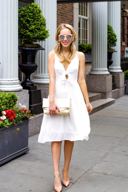 With white clutch and beige pumps