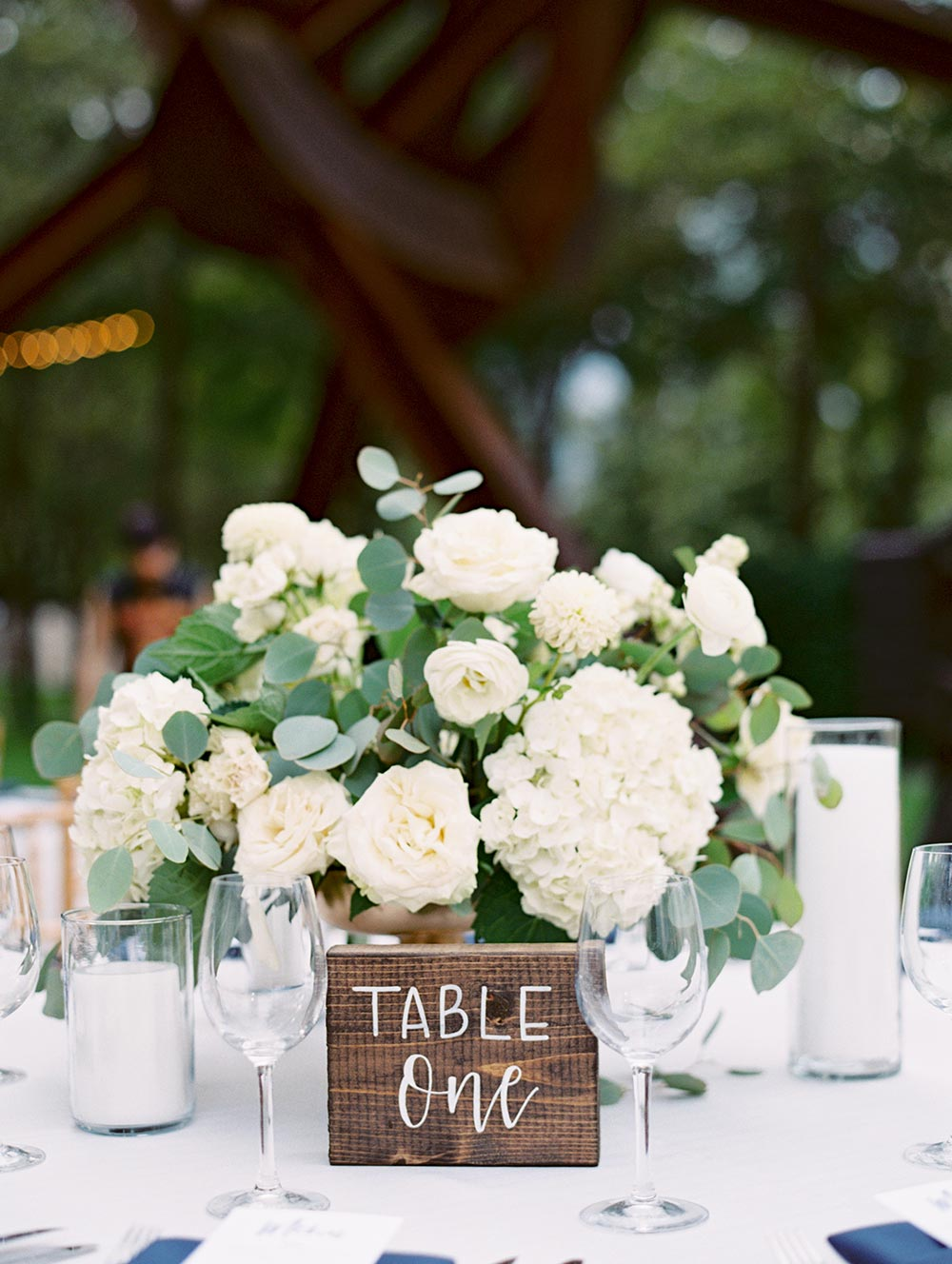 hydrangea and garden rose centerpieces with wooden wedding table numbers