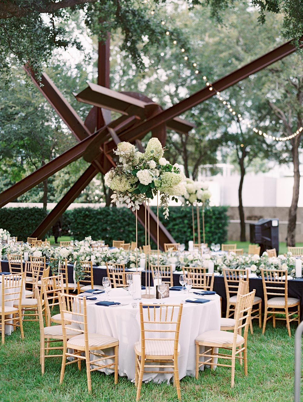sculpture garden wedding reception with tall hydrangea centerpieces