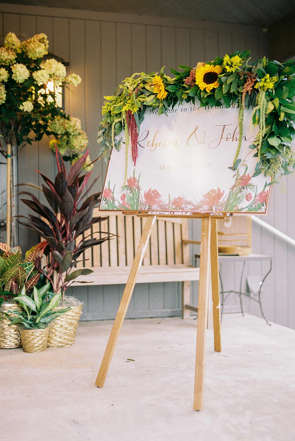 floral wedding signage with sunflower garland