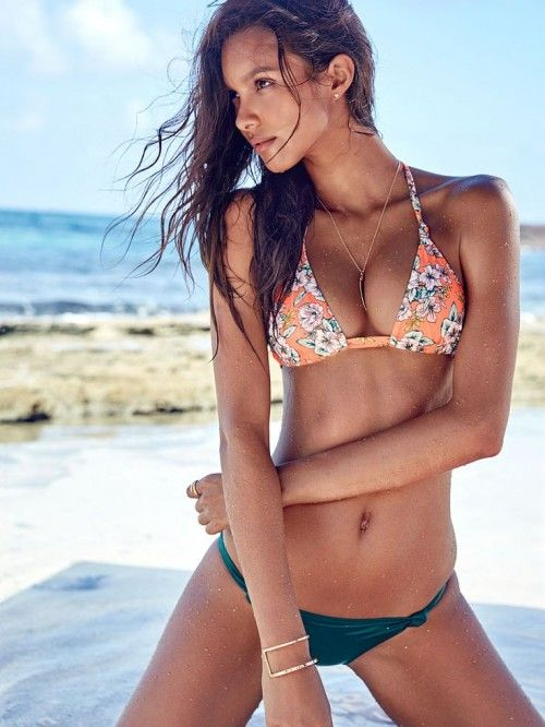 a creative combo of an orange floral bikini top and an emerald bottom for a bright look
