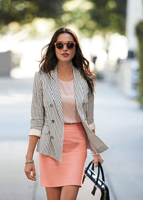 a pink skirt, a blush top, a striped black and white jacket