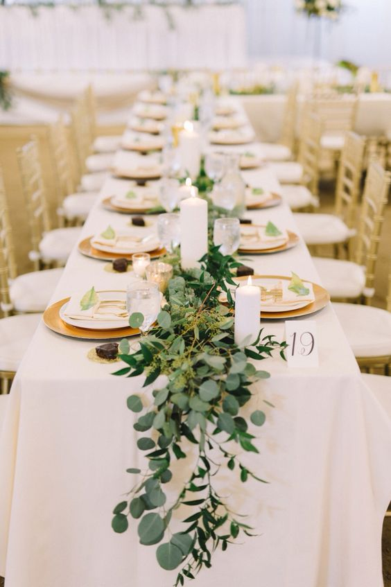 a greenery, foliage and moss wedding table runner is a very refreshing idea for any wedding