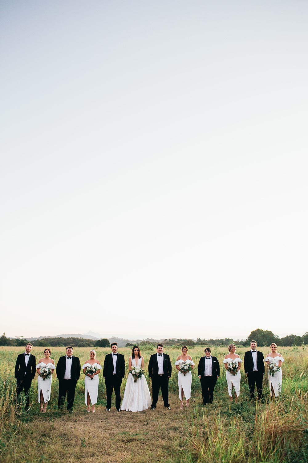 modern bridal party fashion outdoor wedding portraits