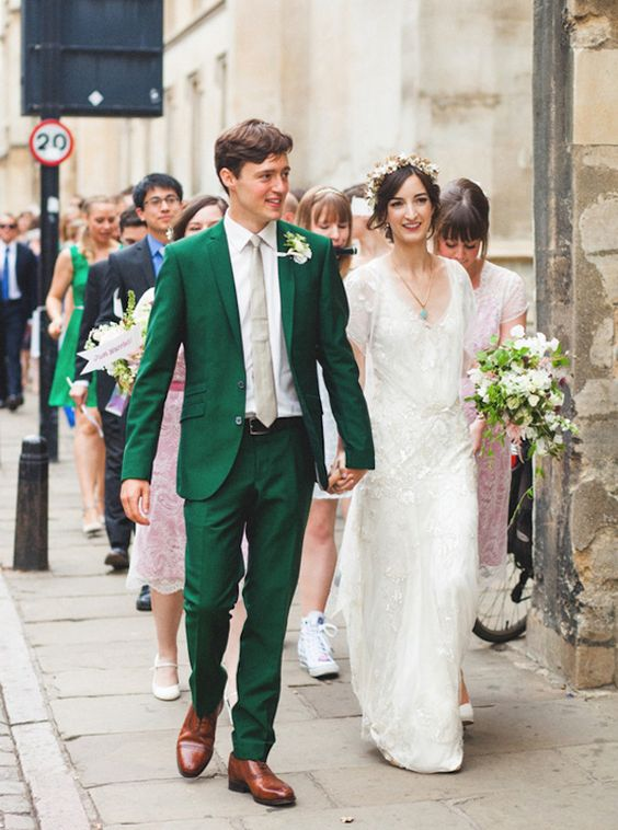 an emerald suit with a nude tie and brown shoes for a stylish vintage-inspired wedding