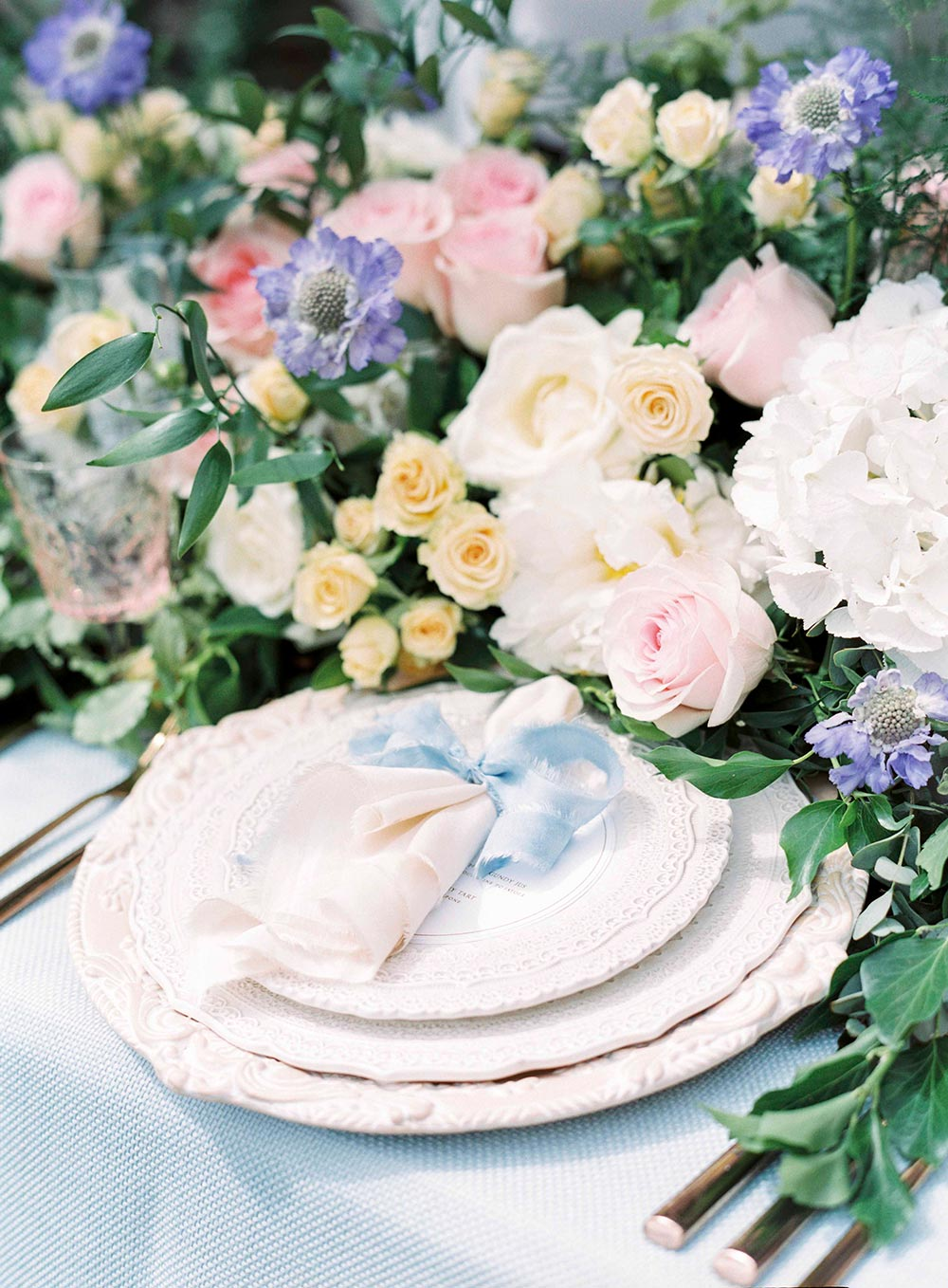 lush pastel wedding flower centerpiece and chic place setting