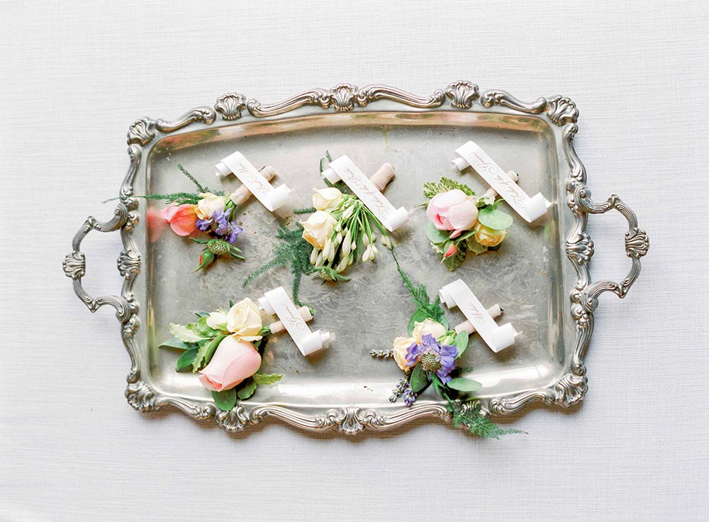 wedding boutonnieres on tray