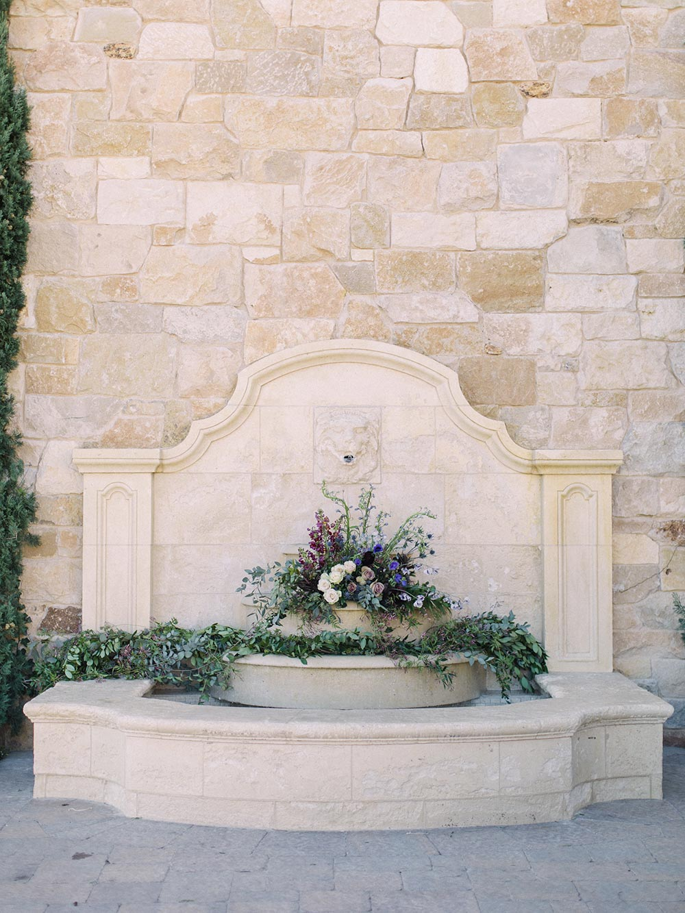 fountain filled with wedding flowers