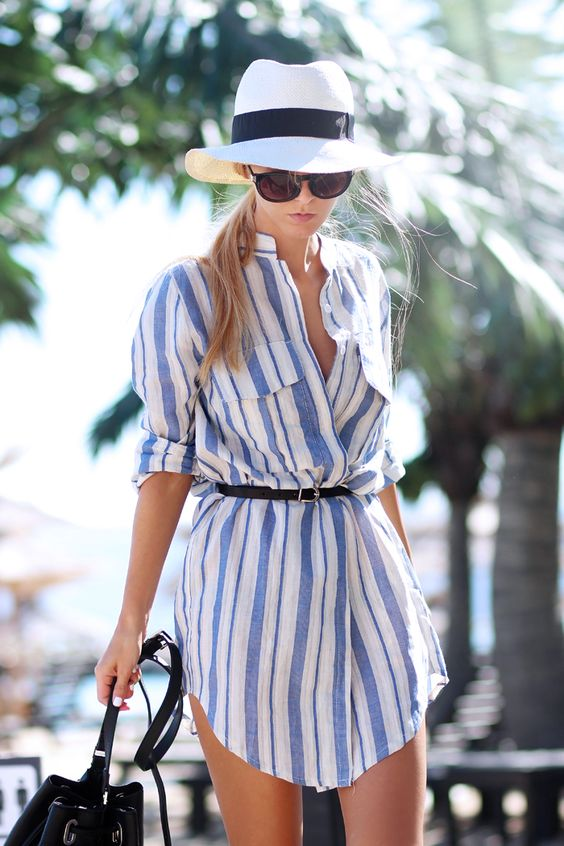 a striped blue and white shirt-style tunic with a thin belt to accent the waist