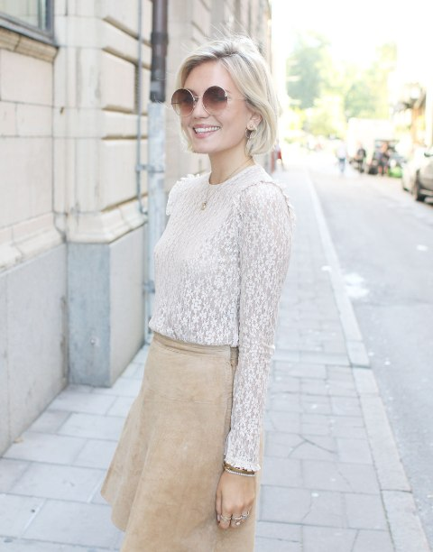 With beige suede mini skirt