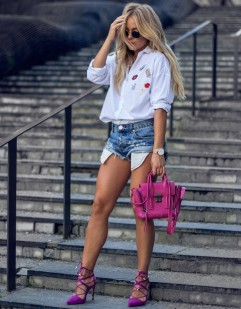 With white button down shirt, purple high heels and pink bag