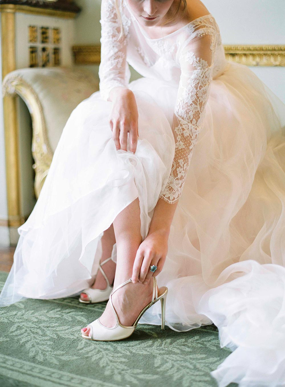 long sleeve lace and tulle wedding dress with strappy bridal heels