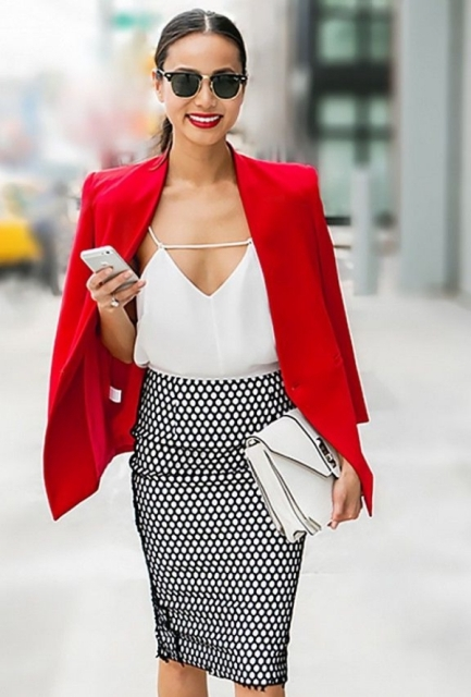 With printed skirt, red blazer and white clutch