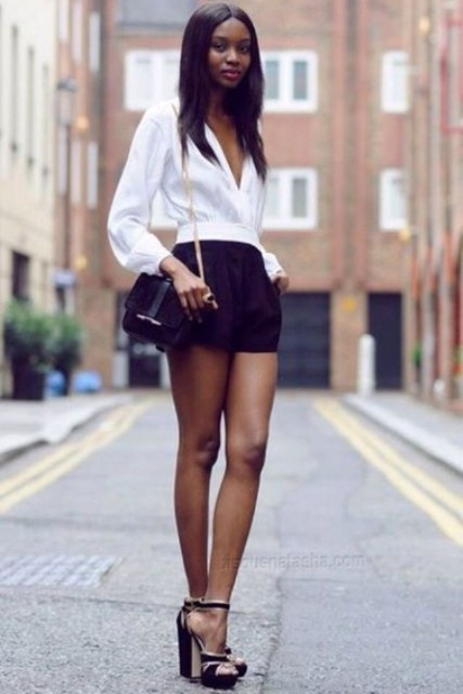 With black shorts, black heeled sandals and mini bag