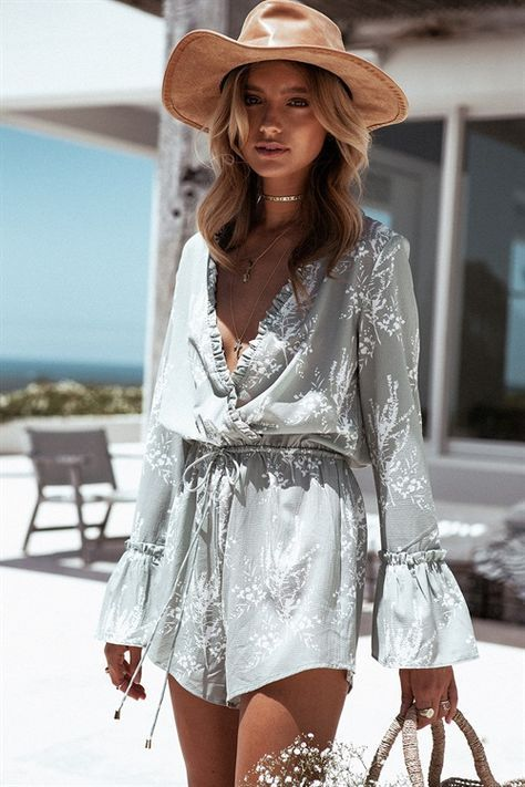 a grey romper with white floral prints, ruffles, bell sleeves for a free-spirited look
