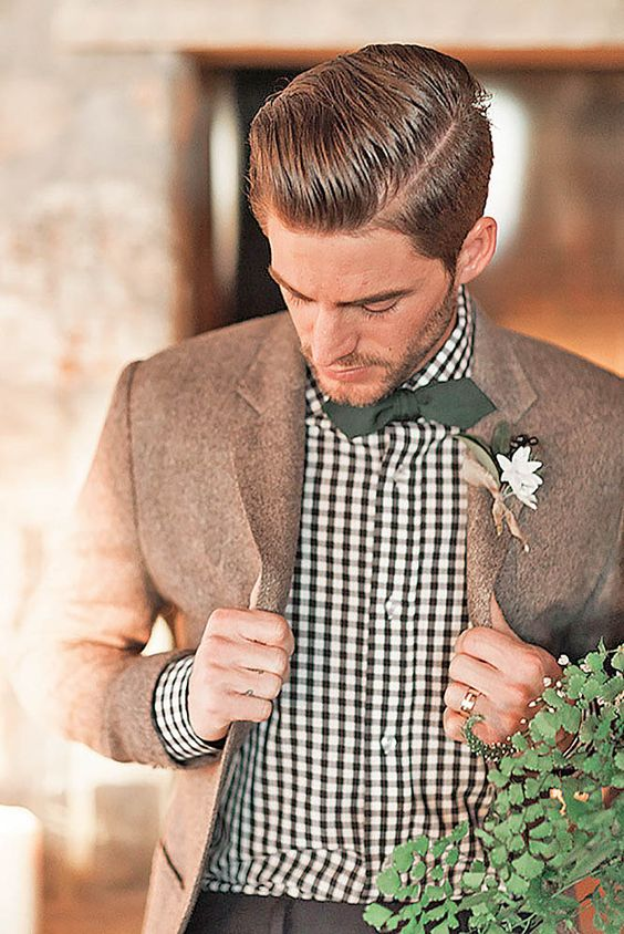 a checked shirt, a brown woolen jacket, a dark green bow tie for a woodland fall groom