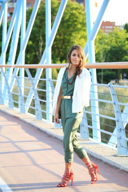 With olive green jumpsuit, red high heels and white blazer