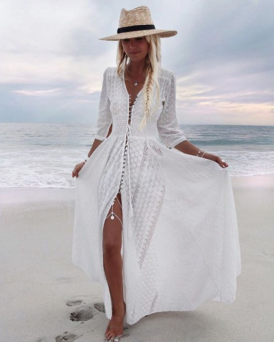 a white boho lace maxi dress with long sleeves is a trendy piece
