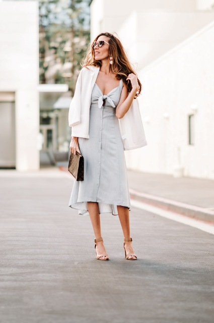 With white blazer, printed clutch and beige sandals