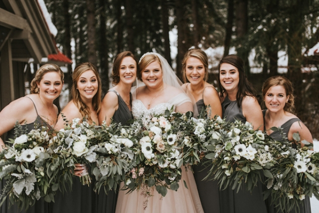 The bridesmaids were wearing mismatching maxi dresses in graphite grey