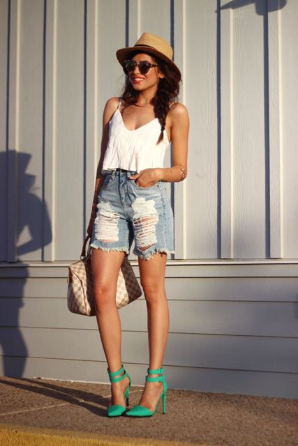 With white top, hat, green shoes and printed bag