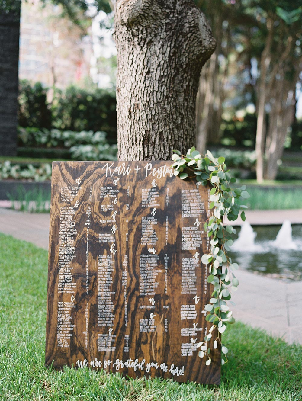 wooden wedding calligraphy signage seating chart