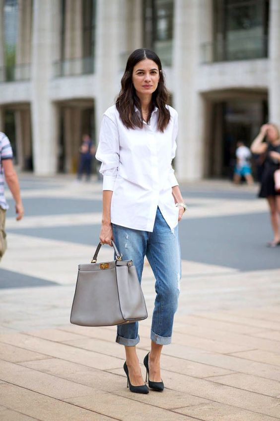 a white shirt, blue boyfriends, black heels and a grey bag for casual classic style