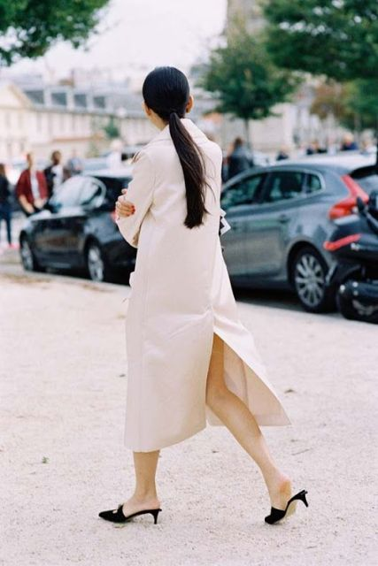 With dress and beige trench coat
