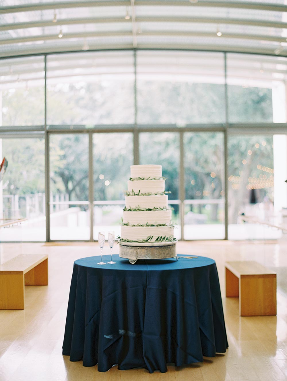 5 tier wedding cake with greenery