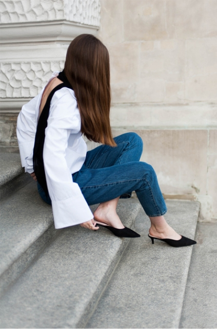 With jeans and white loose shirt