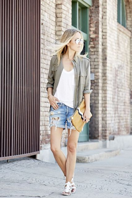 With loose shirt, button down shirt, clutch and white sandals