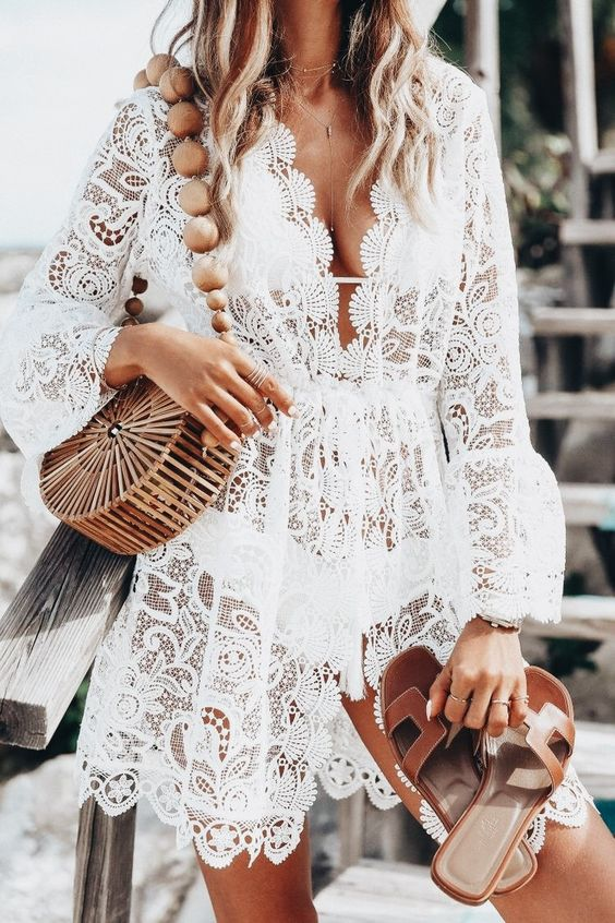 a gorgeous white lace sheer beach tunic with bell sleeves and a plunging neckline for a chic boho look