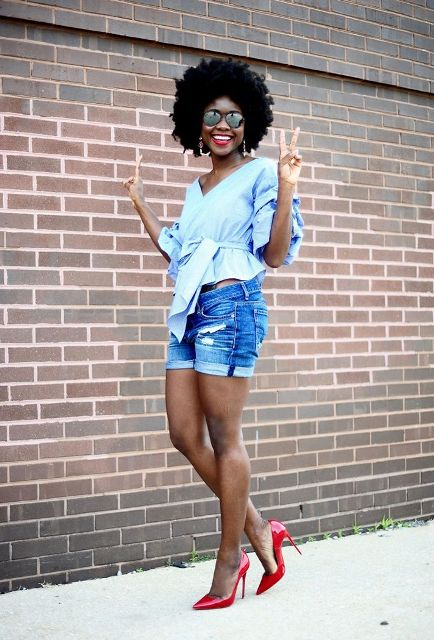 With light blue blouse and red pumps