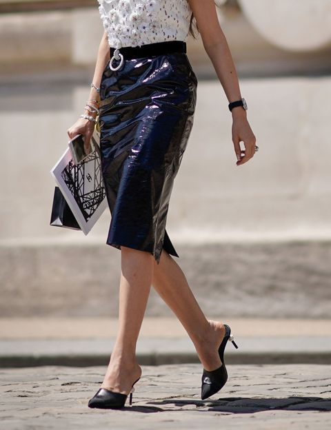 With patent leather knee-length skirt and blouse