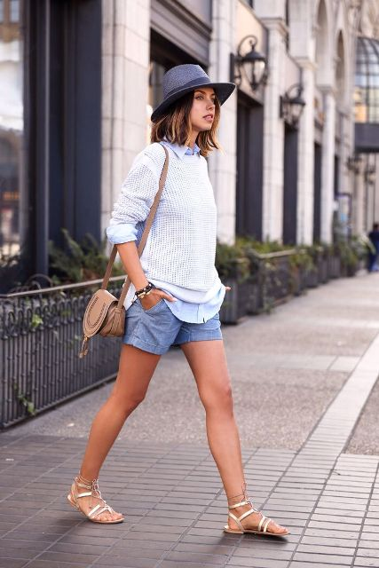 With sweatshirt, blue shorts, hat and crossbody bag