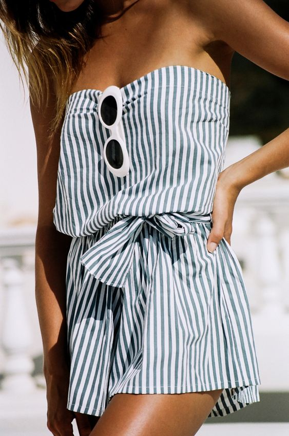 a strapless striped romper with a sash for a coastal-inspired feel