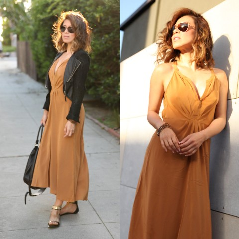 With orange maxi dress, black jacket and black bag