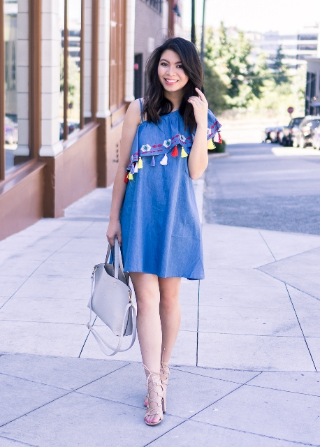 With light gray bag and lace up sandals