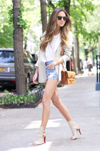 With white t-shirt, beige blazer, brown bag and cutout shoes