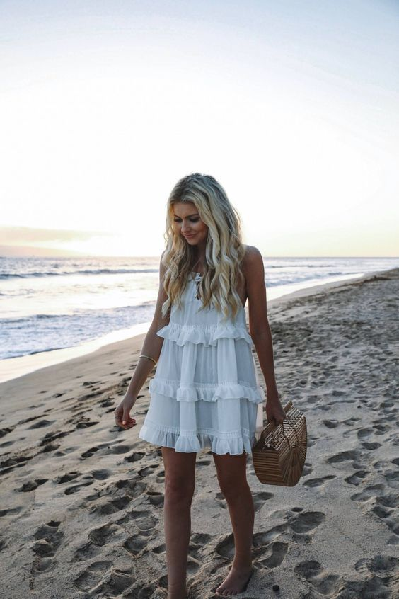 a white ruffled mini dress is a timeless idea, suitable for many girls