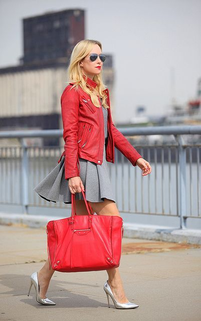 With gray dress, silver pumps and red jacket