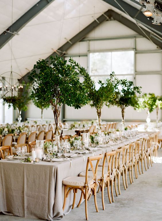 such tall foliage centerpieces remind of real trees and bring an organic feel to the space making it outdoorsy]