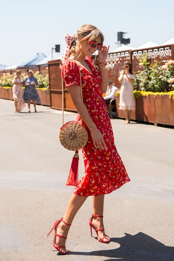 a hot red floral print midi dress with short sleeves and a V-neckline, striped shoes and a round straw bag