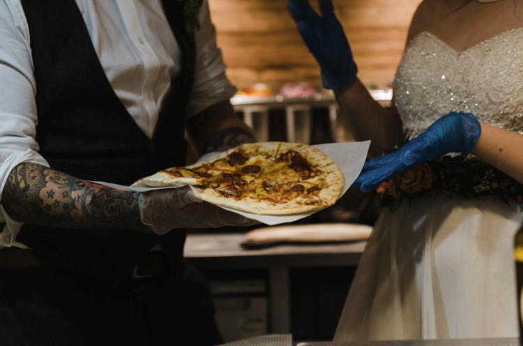 The couple participated in cooking pizza for the guests