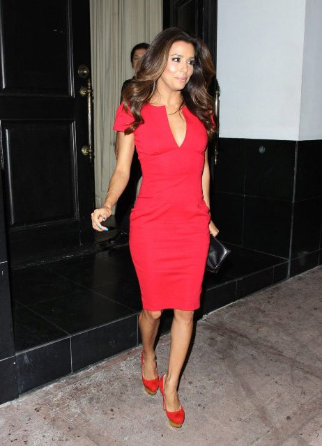 With red shoes and black clutch